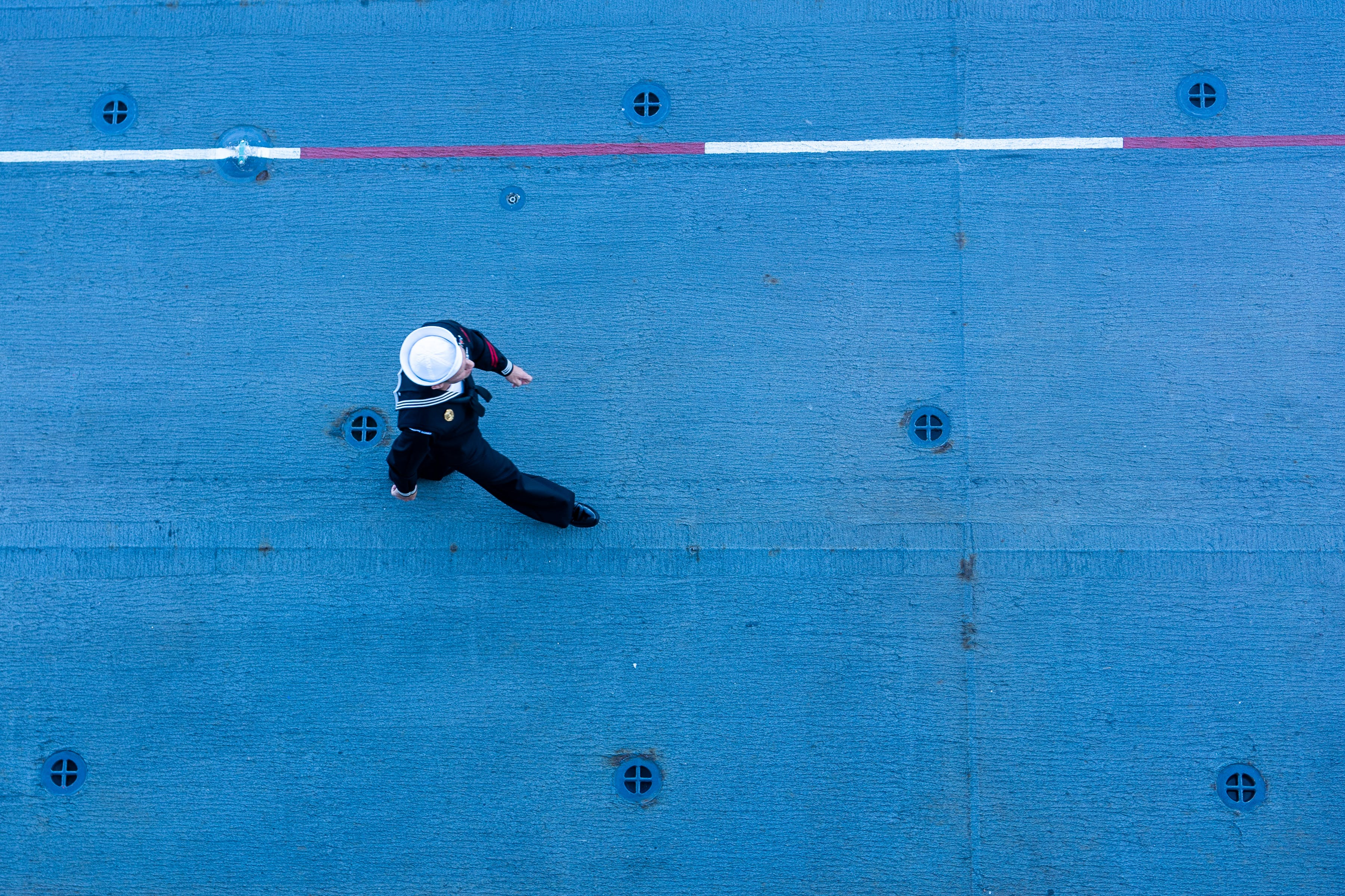 Sailor Walking on a Ships Deck