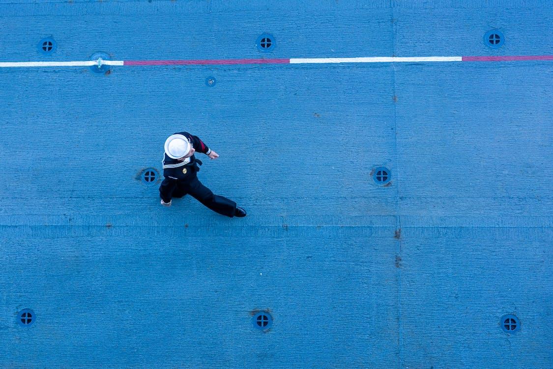 Sailor Walking on a Ships Deck