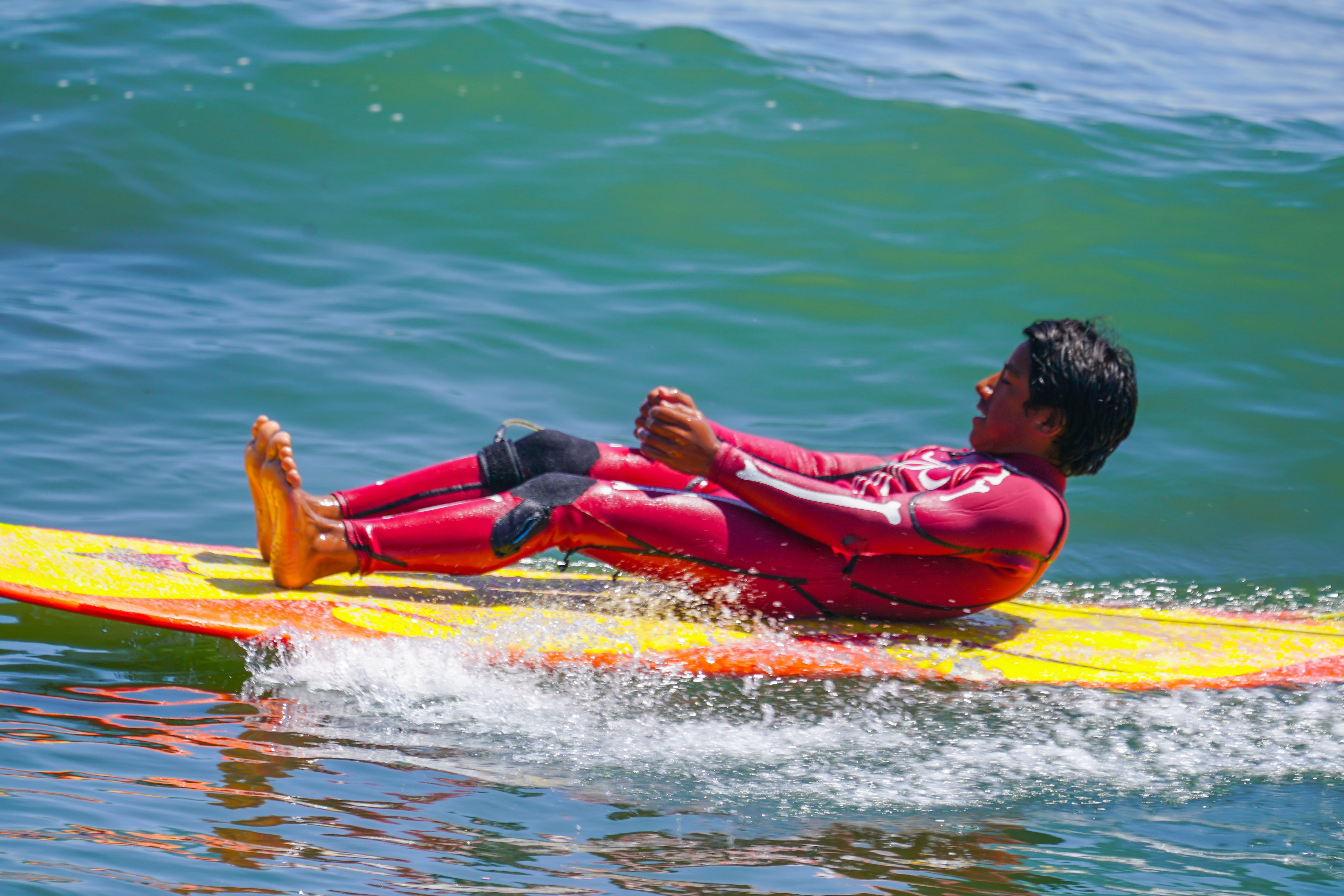 Man Lying Down on a Yellow Surfboard