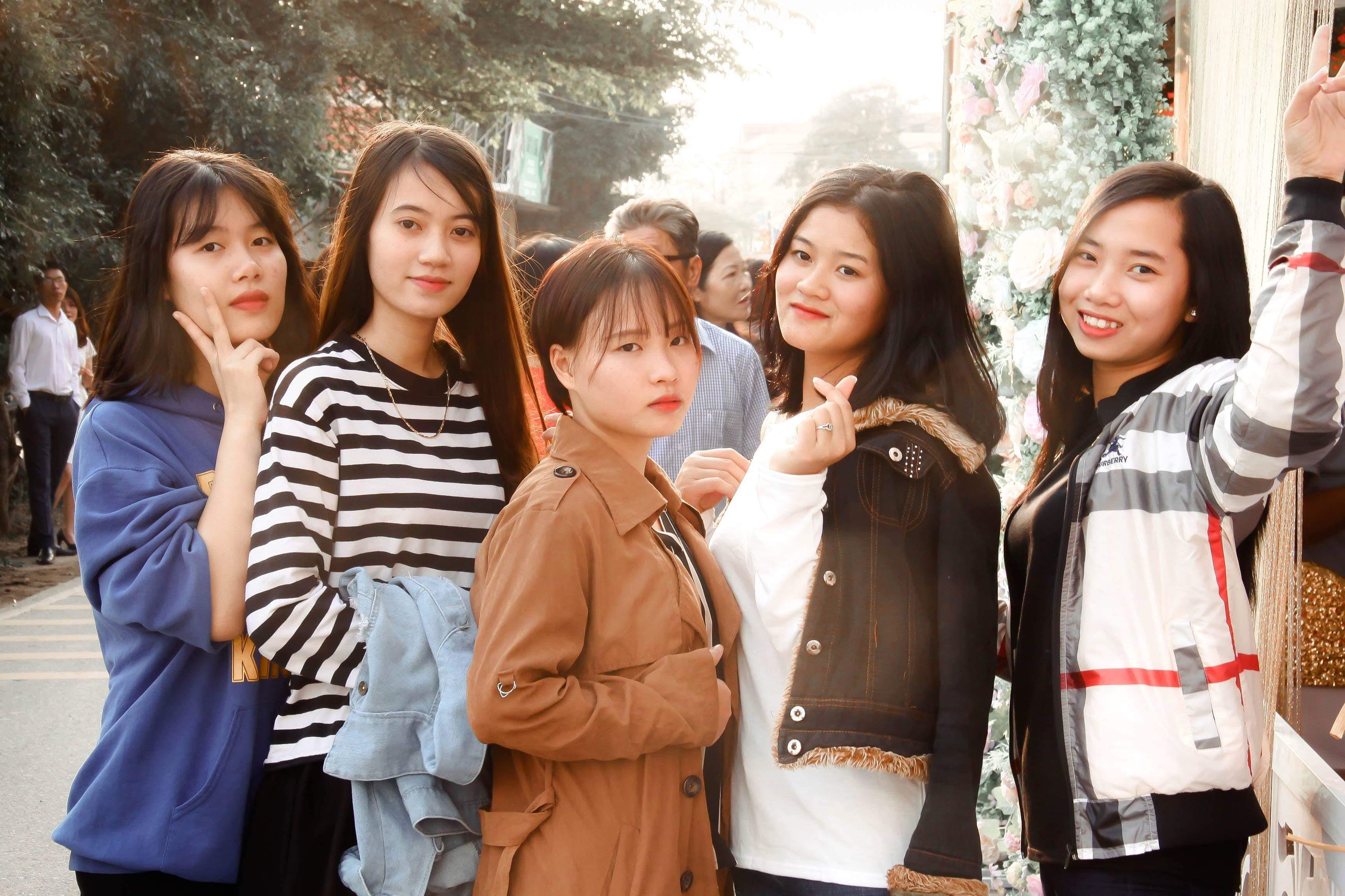 Group of Women Standing Beside Wall