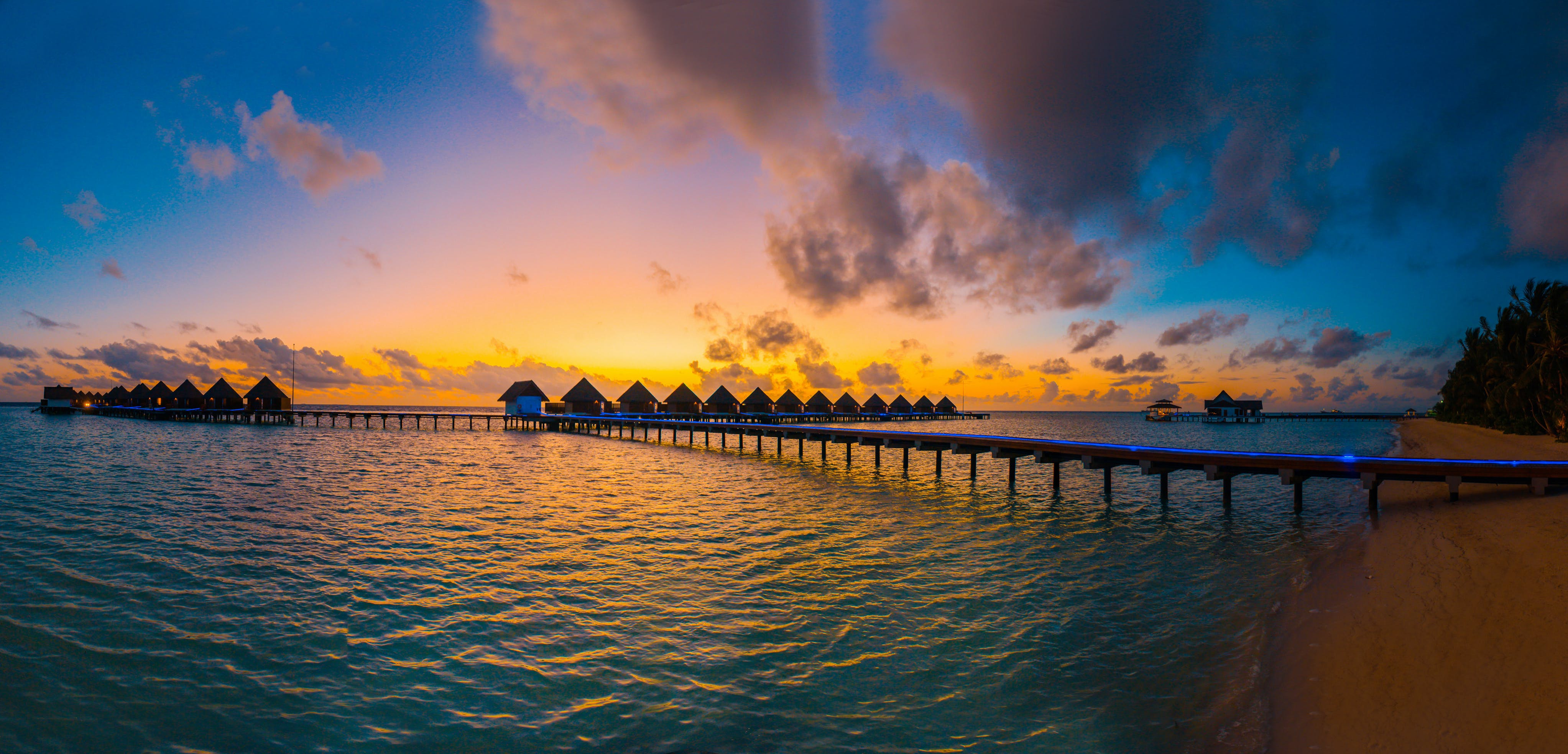 Silhouette Photography of In-lined Cottages in Sea