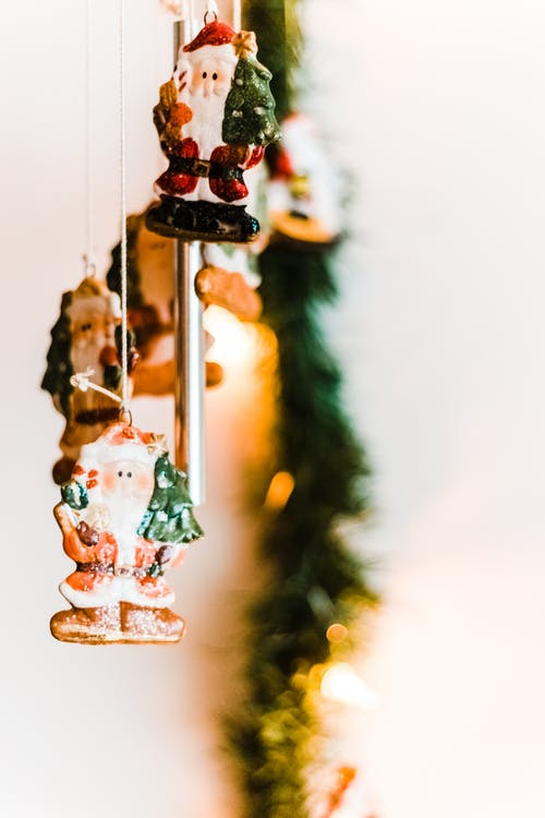 Selective Focus Photography of Santa Claus Wind Chimes