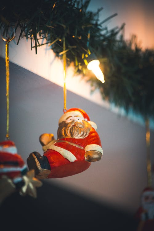 Selective Focus Photography of Santa Clause Hanging Decor