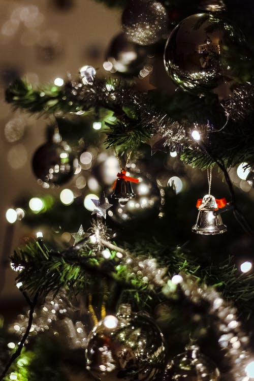 Green Christmas Tree With Silver Bells in Bokeh Photography