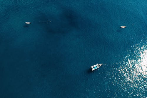 Bird's Eye View Of Boats On Ocean