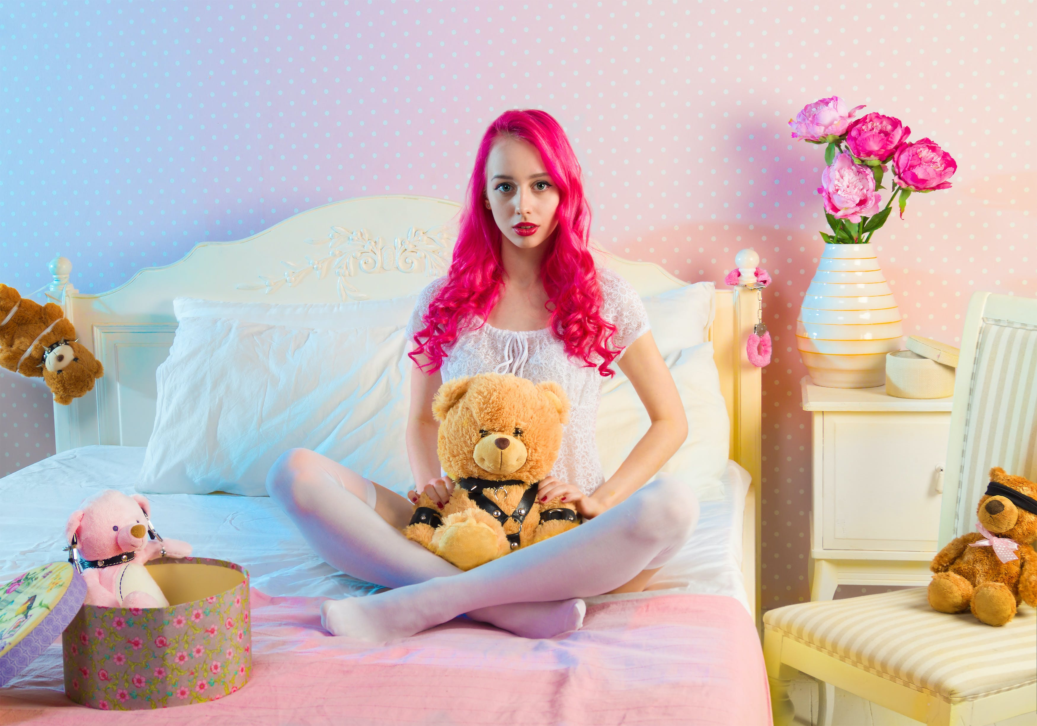 Pink Long Haired Woman Sitting on Double Bed With Bear Plsuh Toy at Daylight