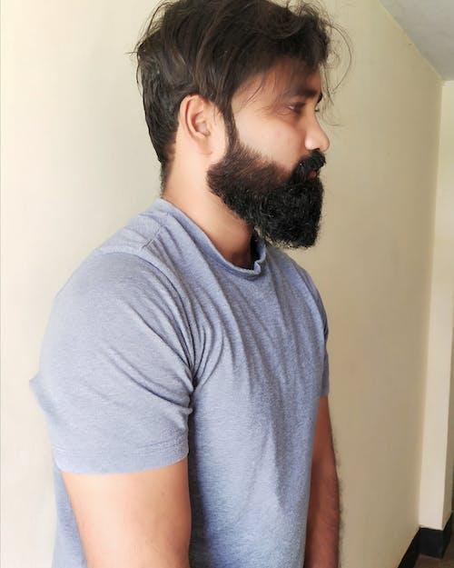 Fotos de stock gratuitas de chaval, chico asiático, chico de barba, de perfil