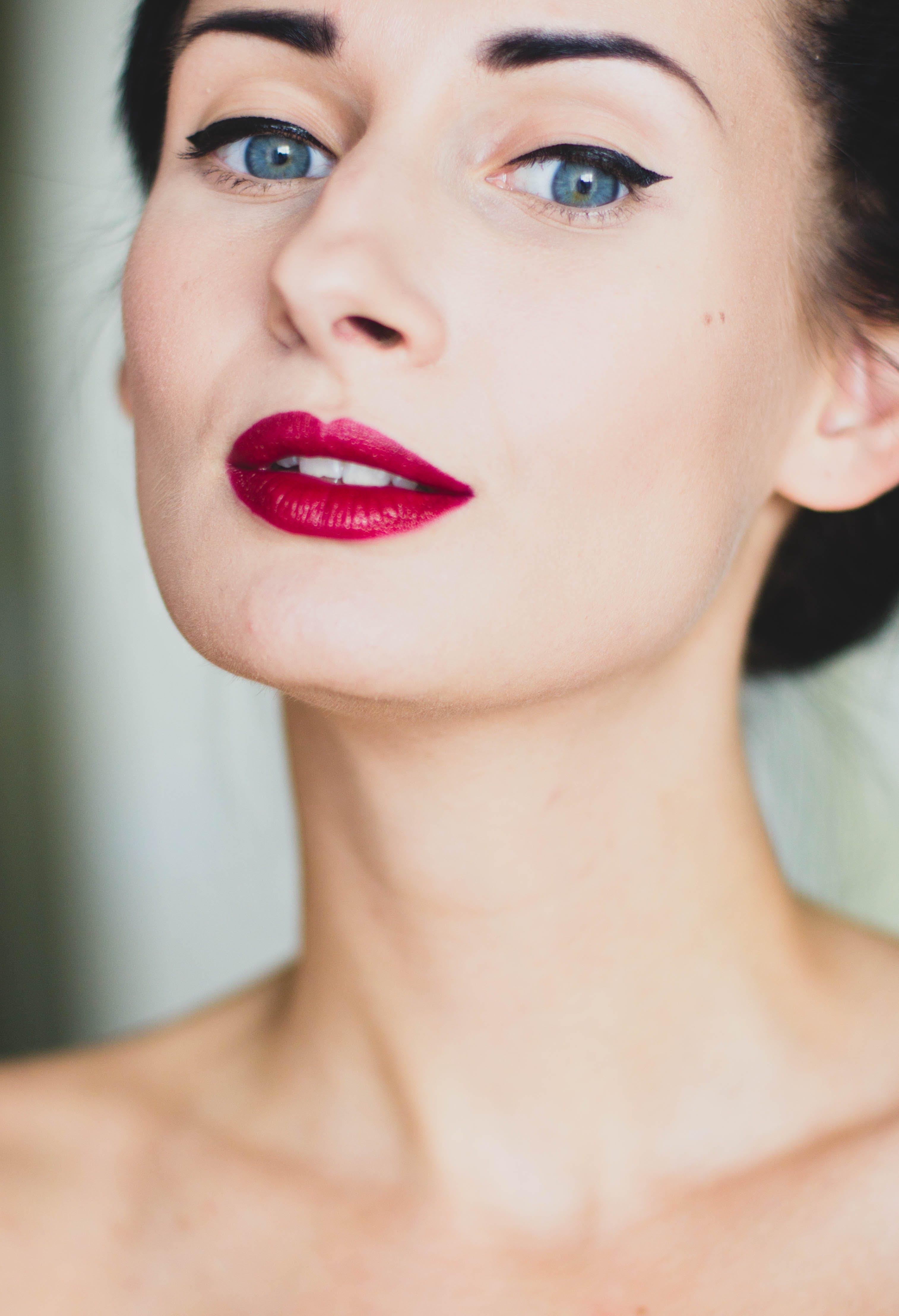 Woman Wearing Makeup Near Beige Wall