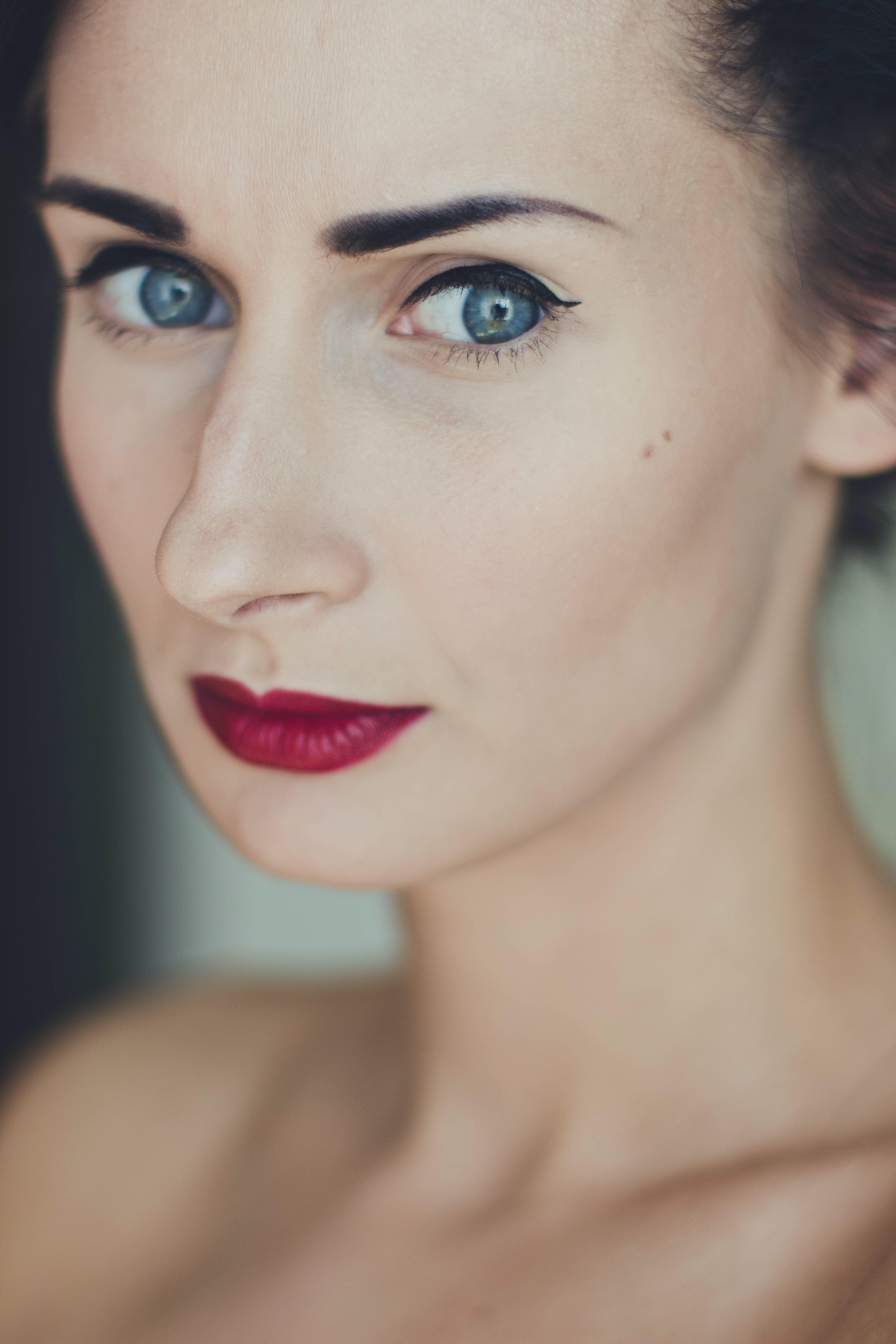 Woman Wearing Black Mascara and Red Lipstick