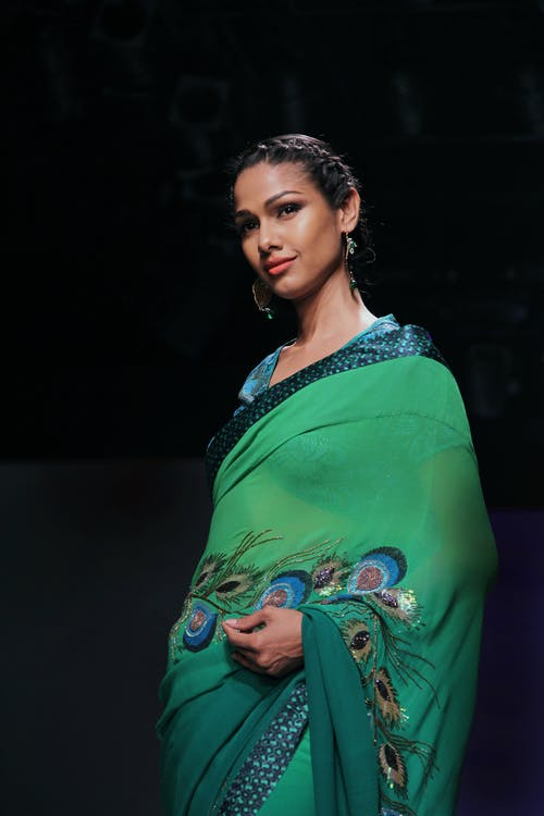Woman Wearing Green Dress and Earrings