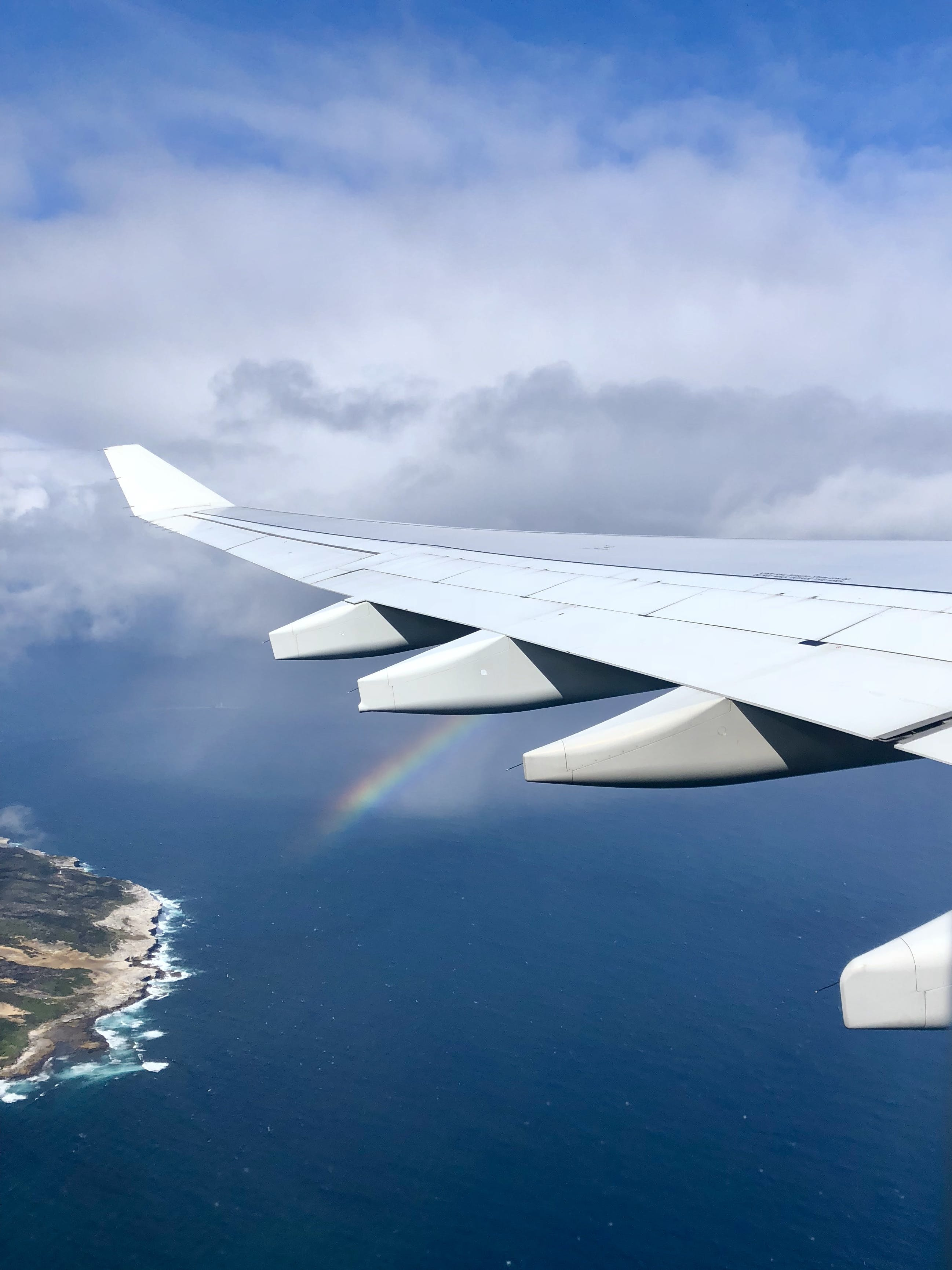 Airplane Wing With Rainbow