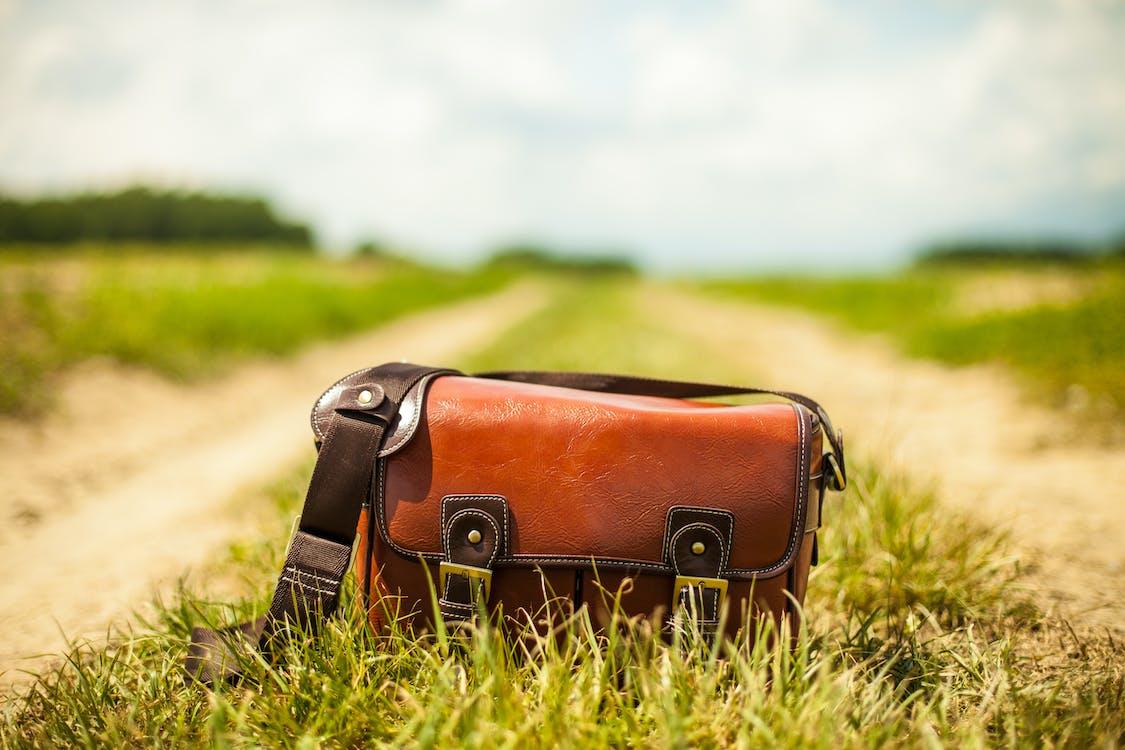 Shallow Focus Photography of Brown Bag
