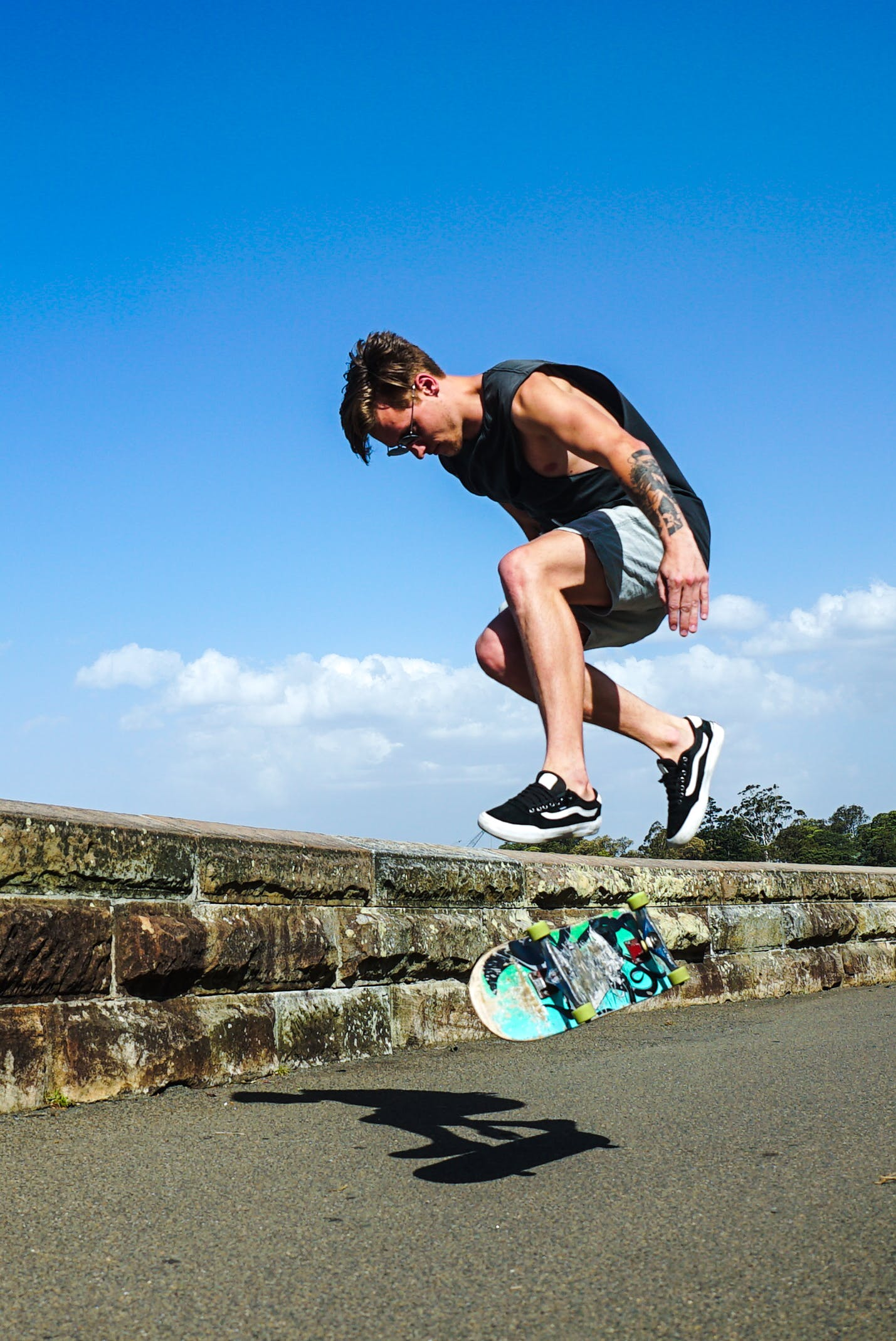 Jumping Man Together With Blue Skateboard