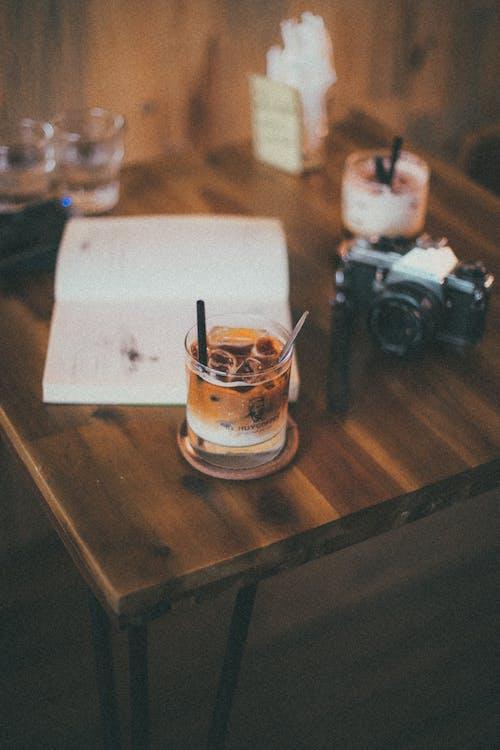 Black Bridge Camera Near Drinking Glass