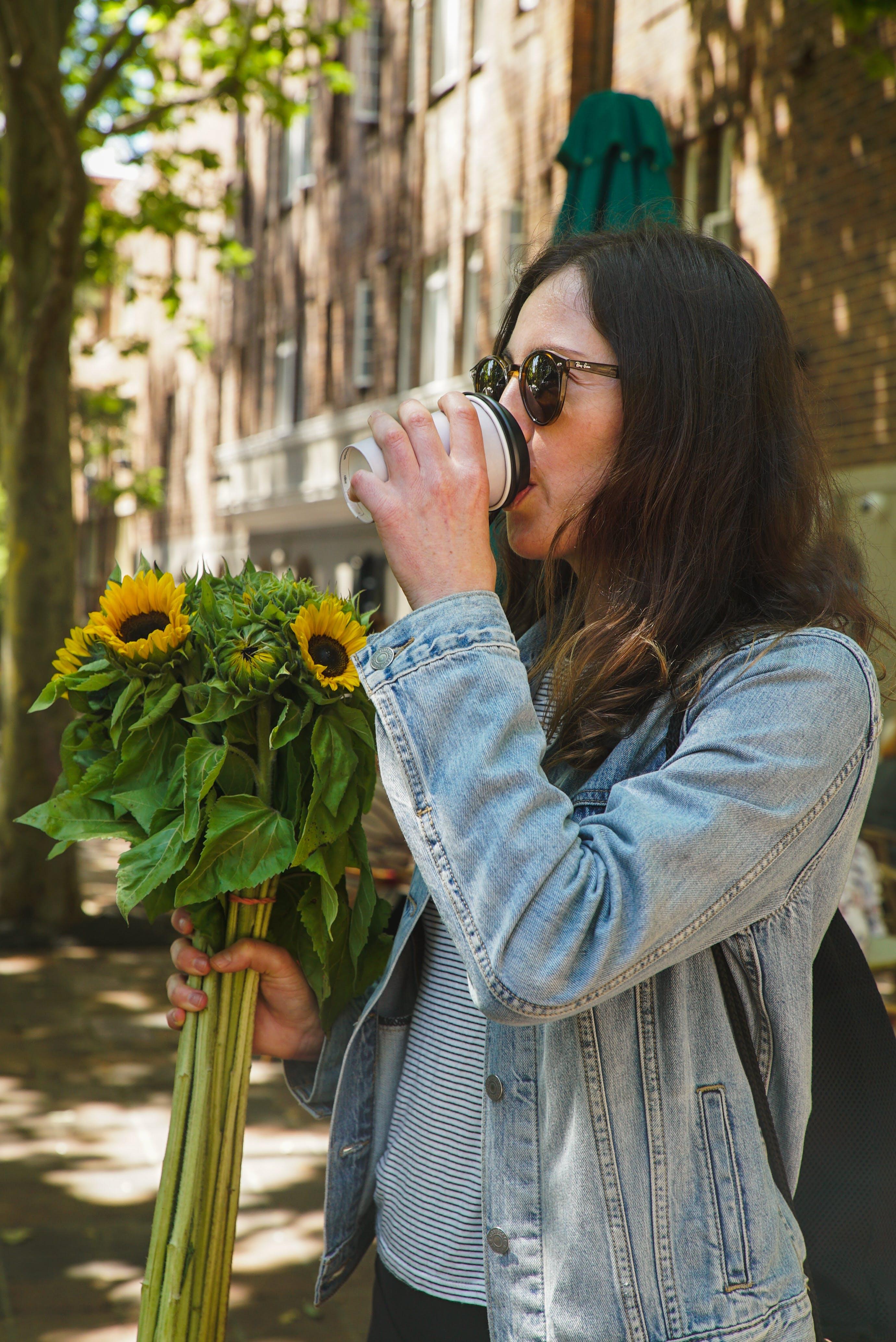 Photo of Woman Drinking Coffee