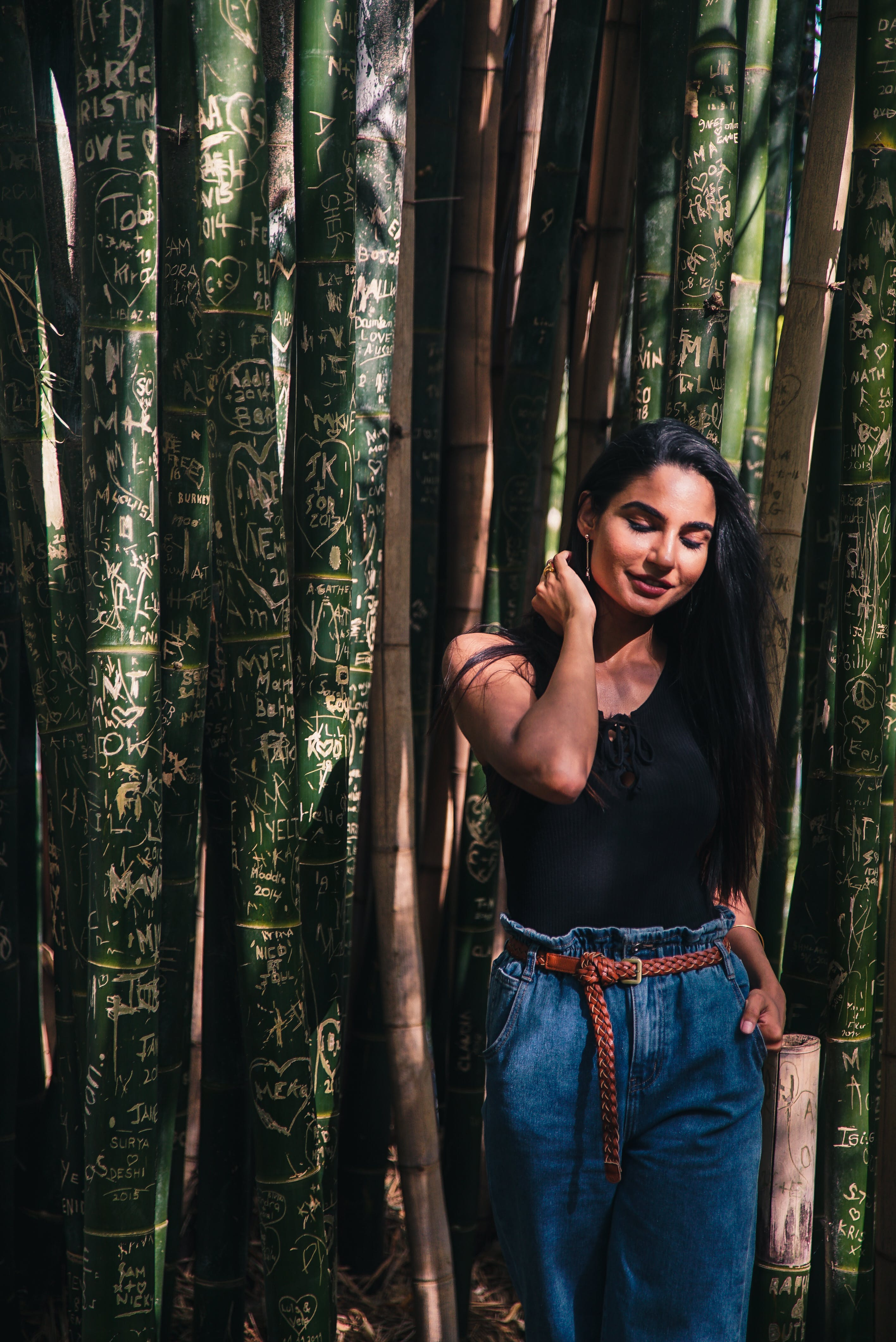 Photo of Woman Standing Near Bamboo Trees
