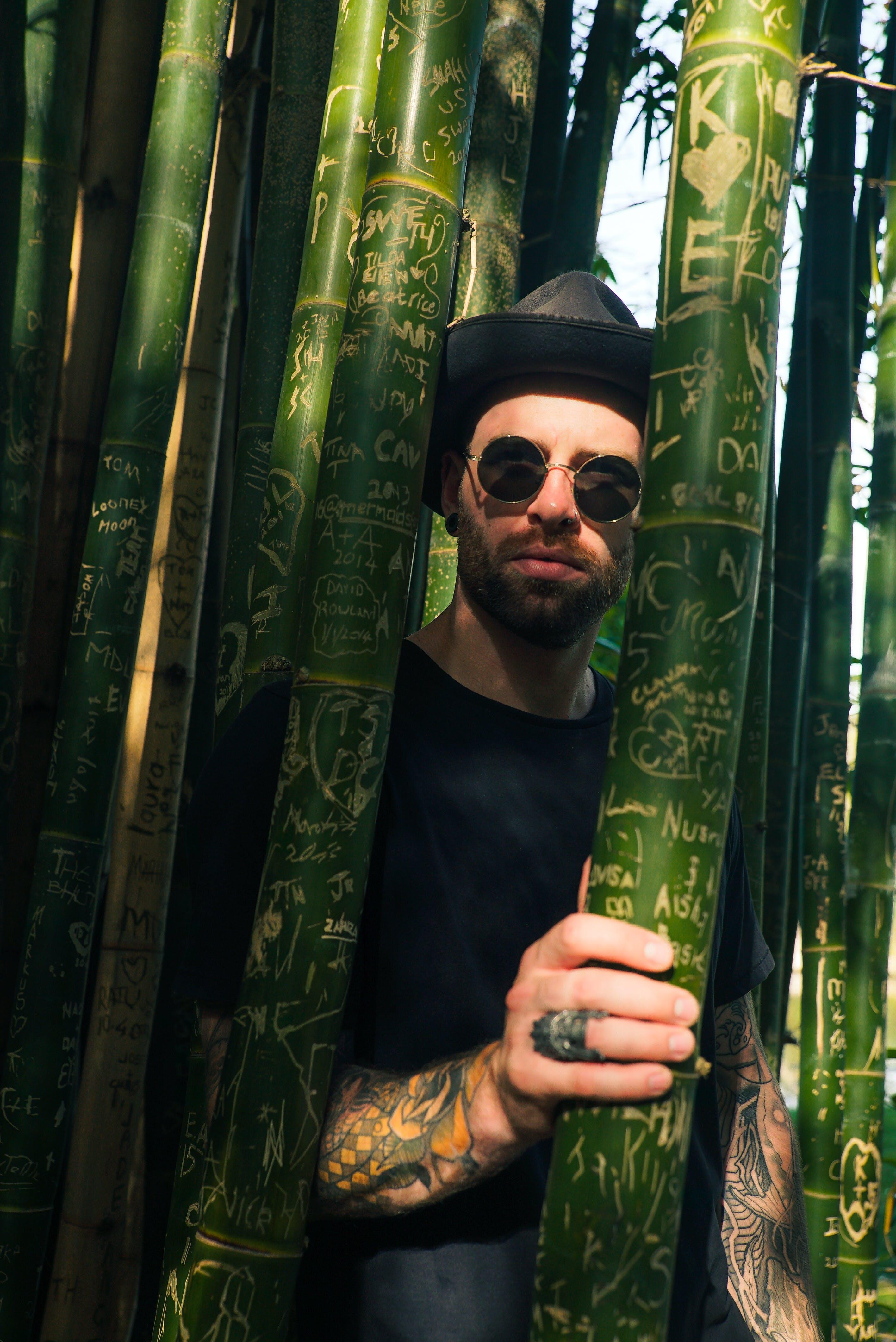 Man Through Bamboo Trees