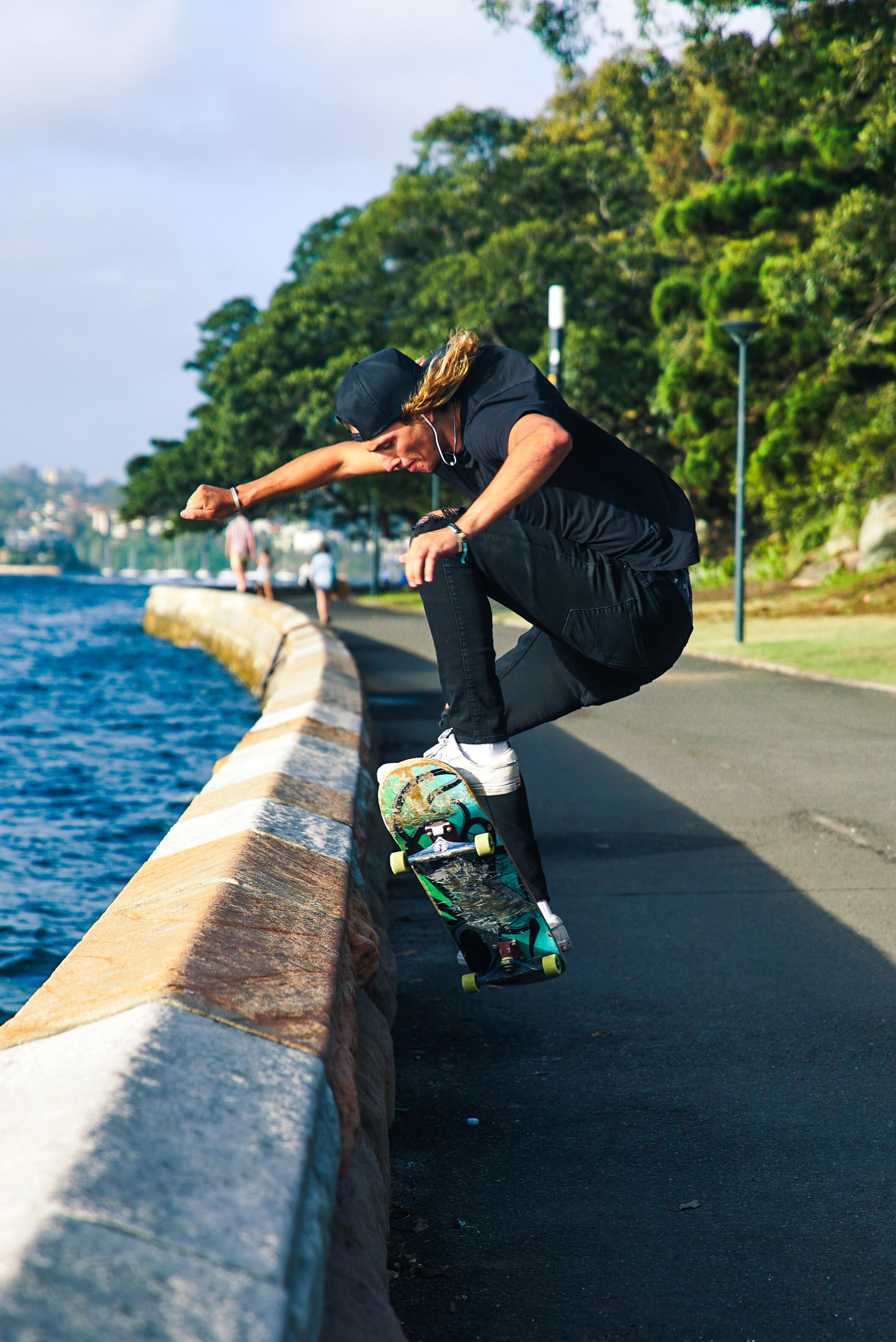 Person Skateboarding Near Lakeside