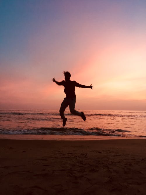 Silhouette of Jumping Man during Sunset
