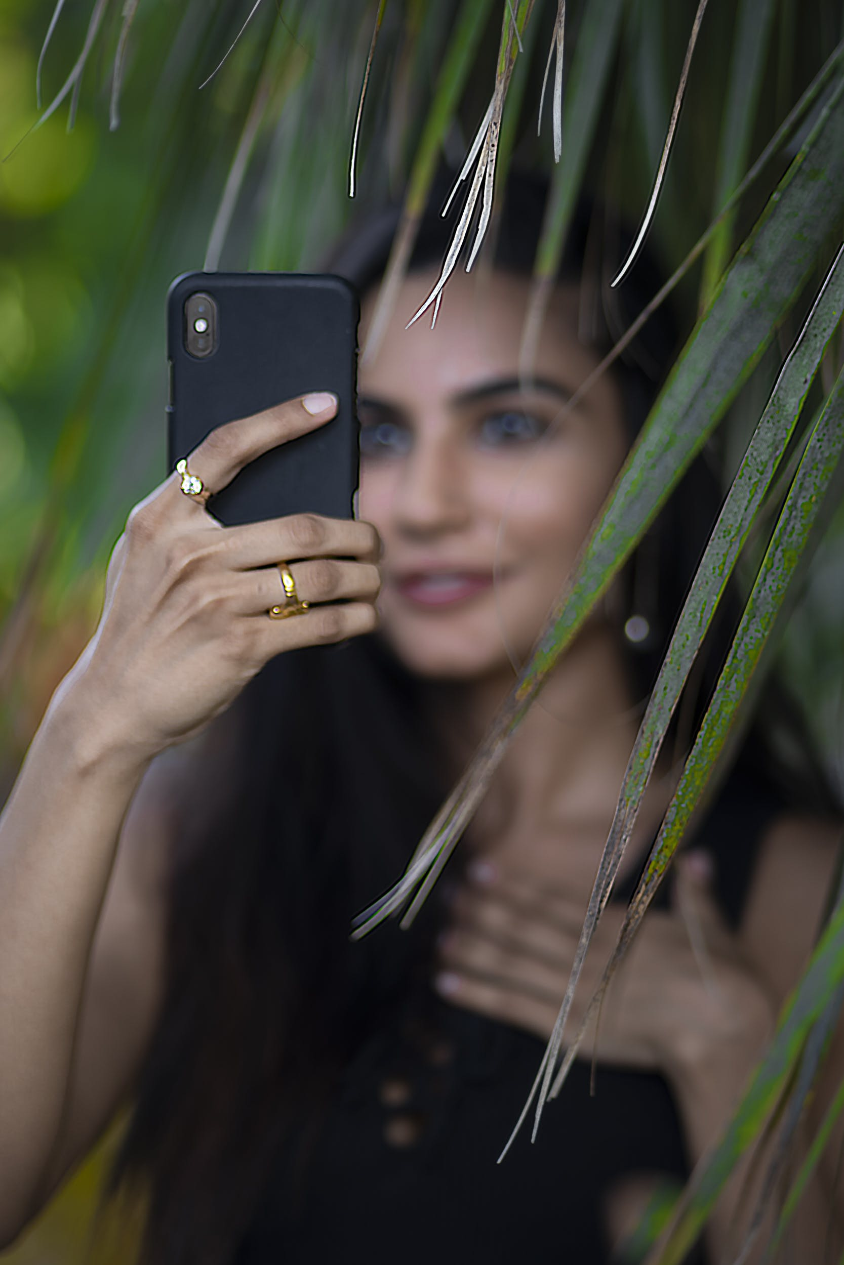 Selective Focus Photo of Woman Holding Phone