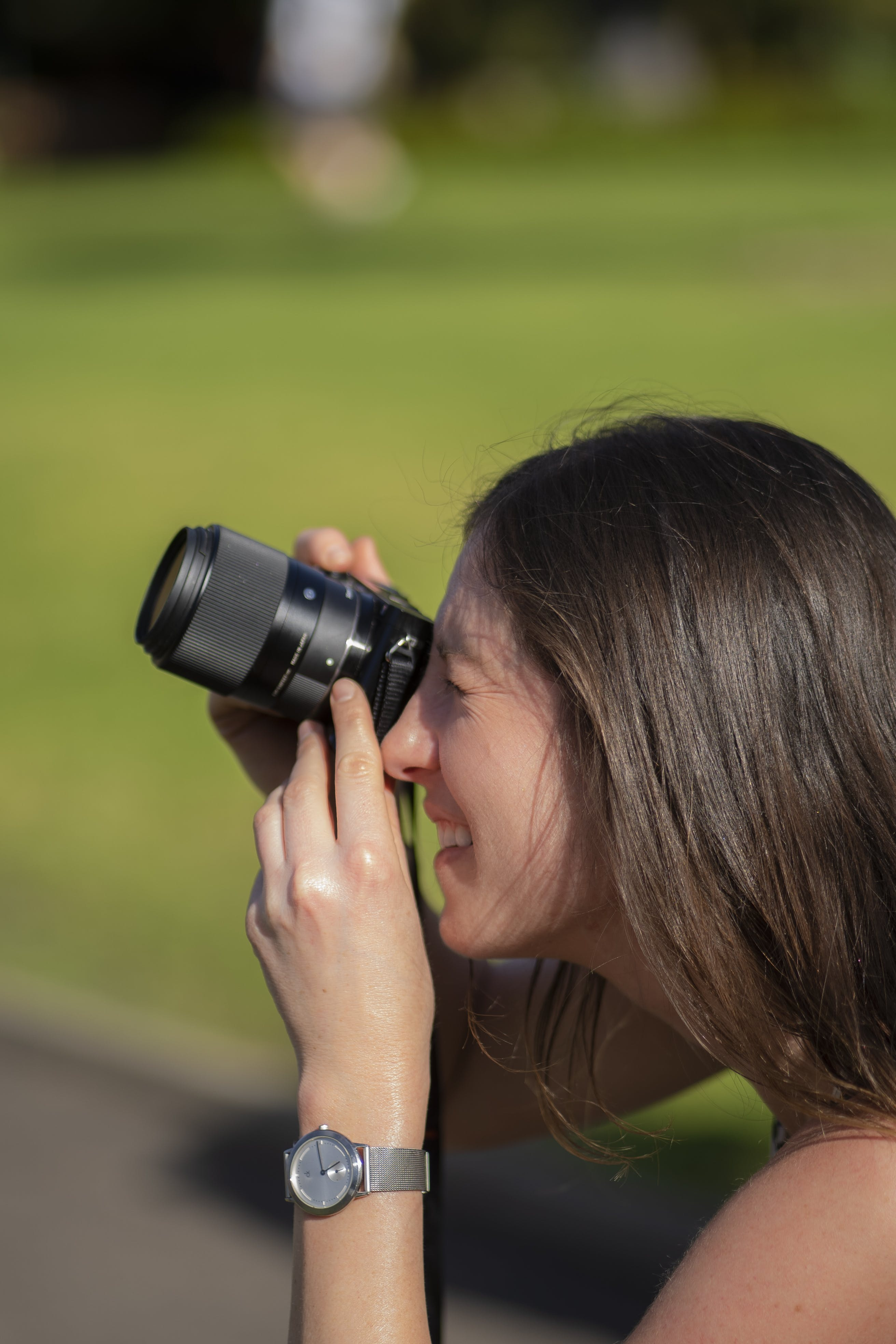 Woman Holding Camera in Bokeh Photography
