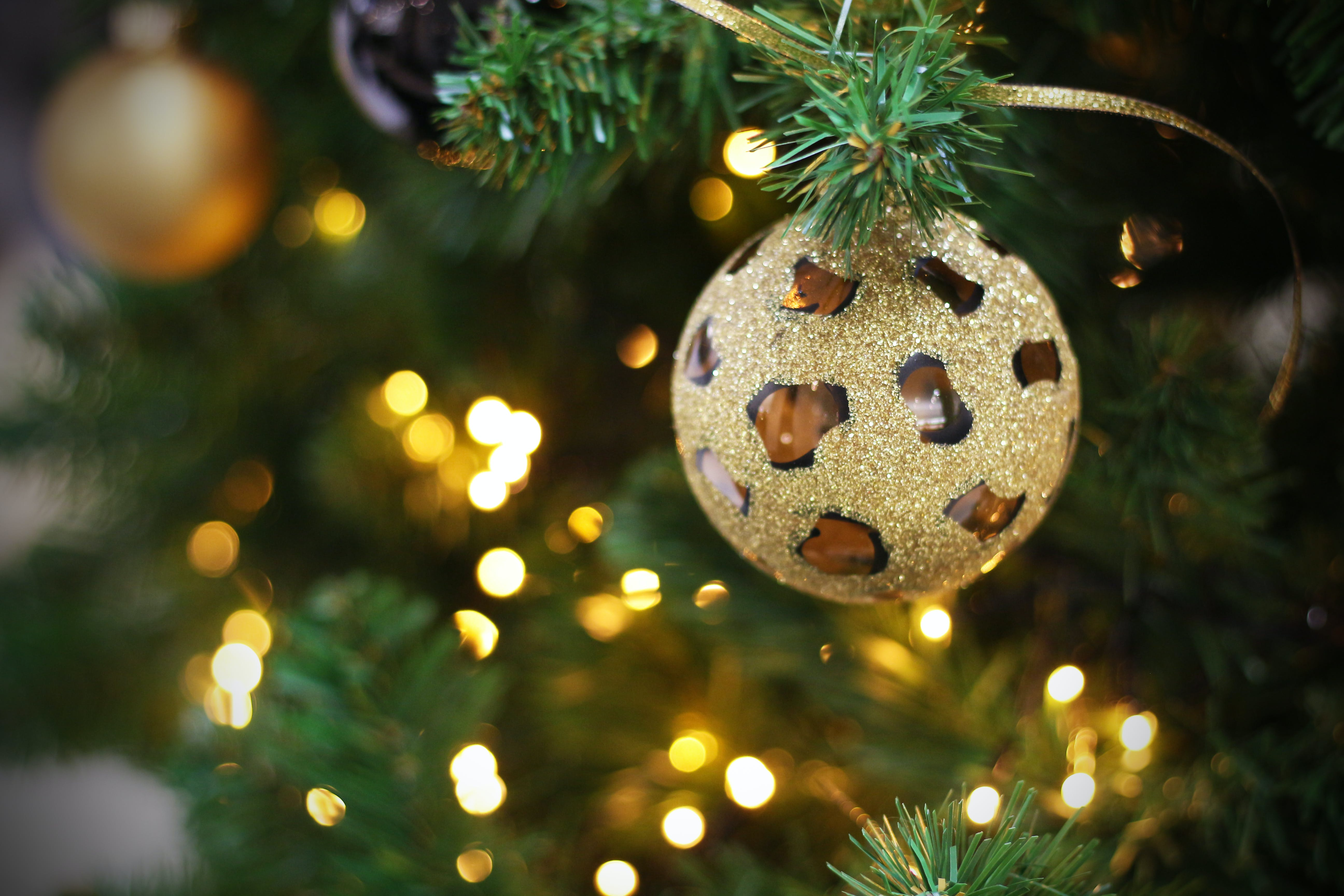Selective Focus Photography Of Gold Bauble Ornament