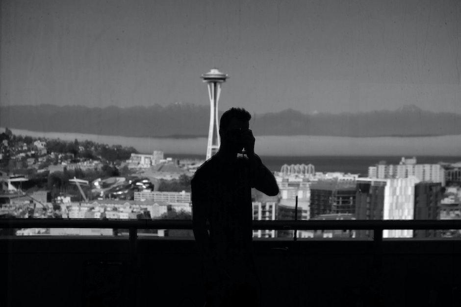 Silhouette of Man Near Handrails