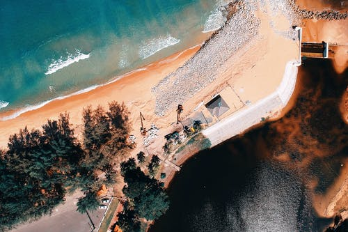 Aerial Photography of House Near Body of Water