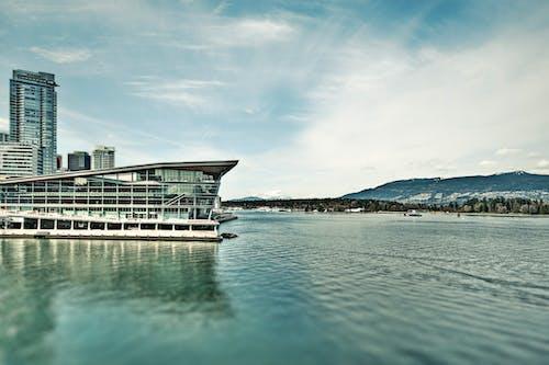 Gratis stockfoto met architectonisch, architectuur, bergen, blauwe lucht