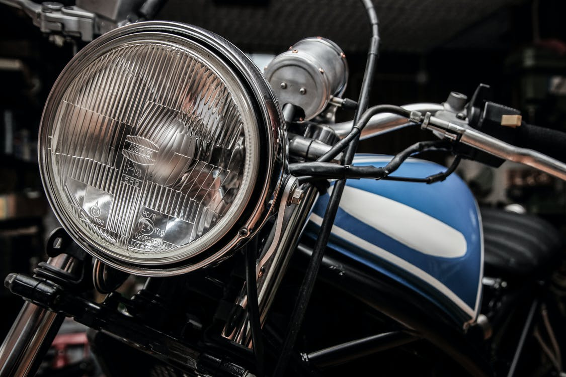 Close-up Photography of Blue and Black Standard Motorcycle