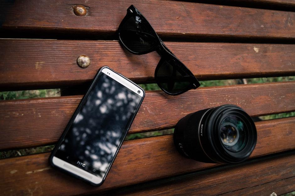 Black Wayfarer Sunglasses Near the Camera Lens