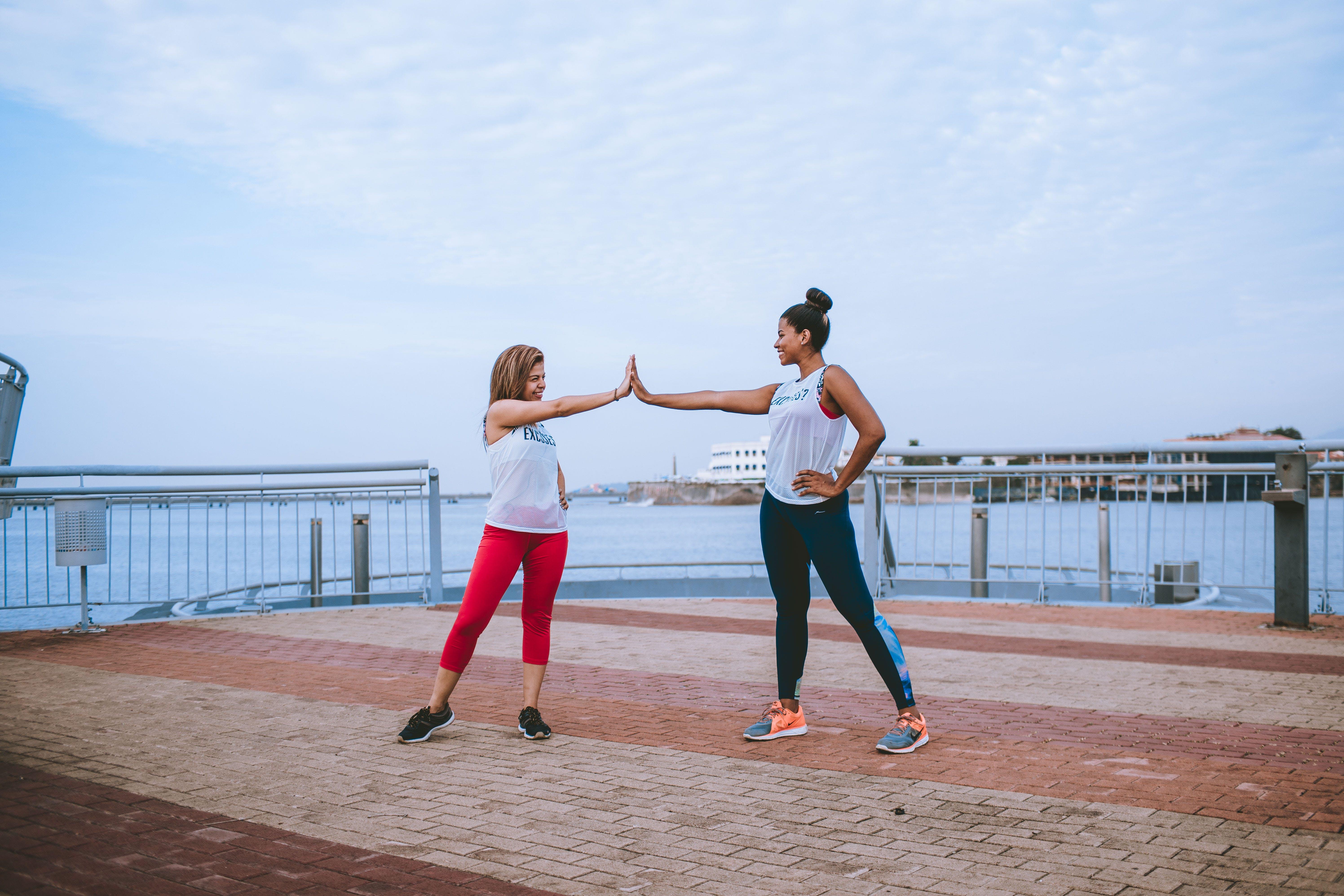 Two Women Wearing Sports Attire