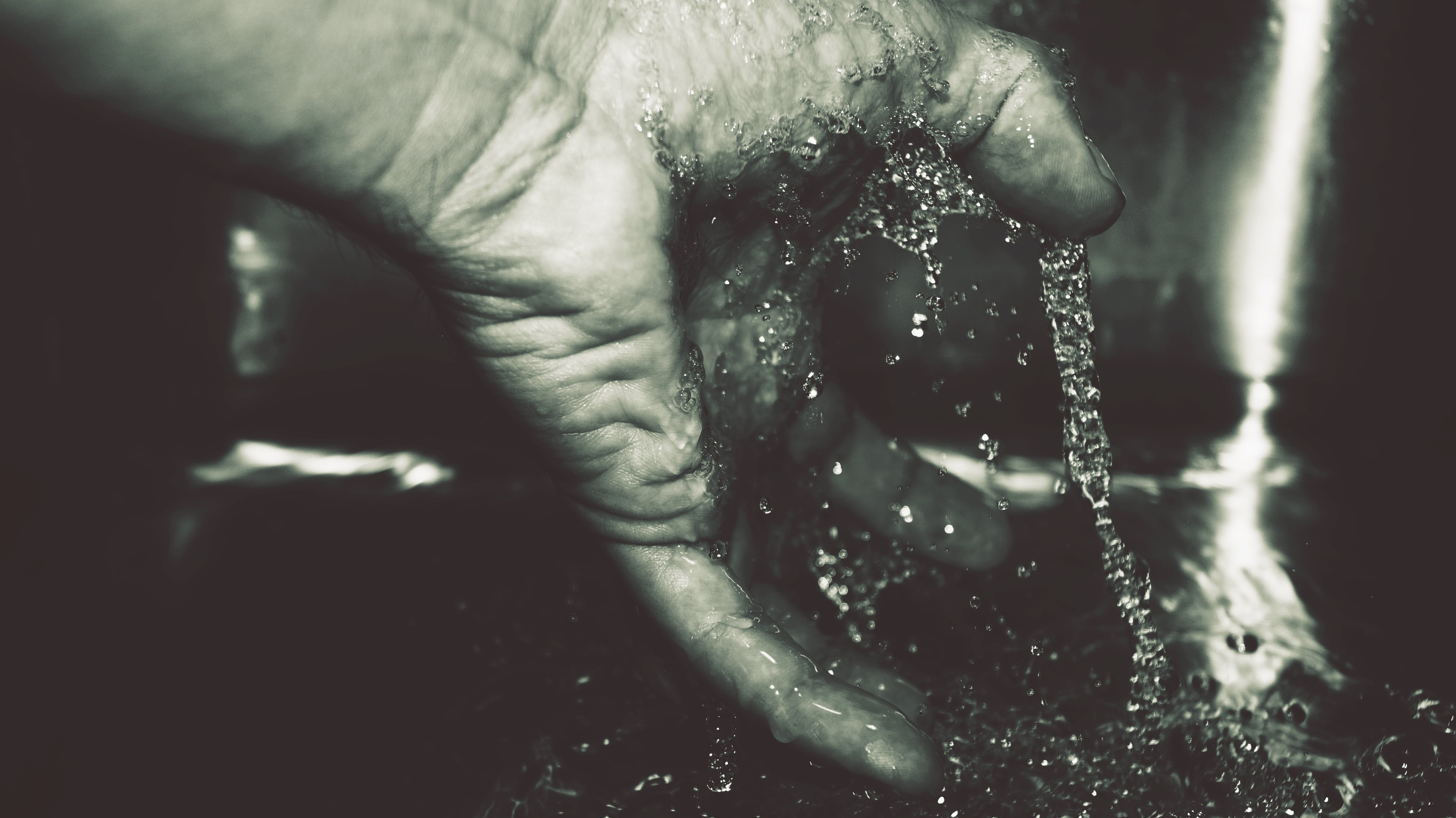 Human Hand With Water