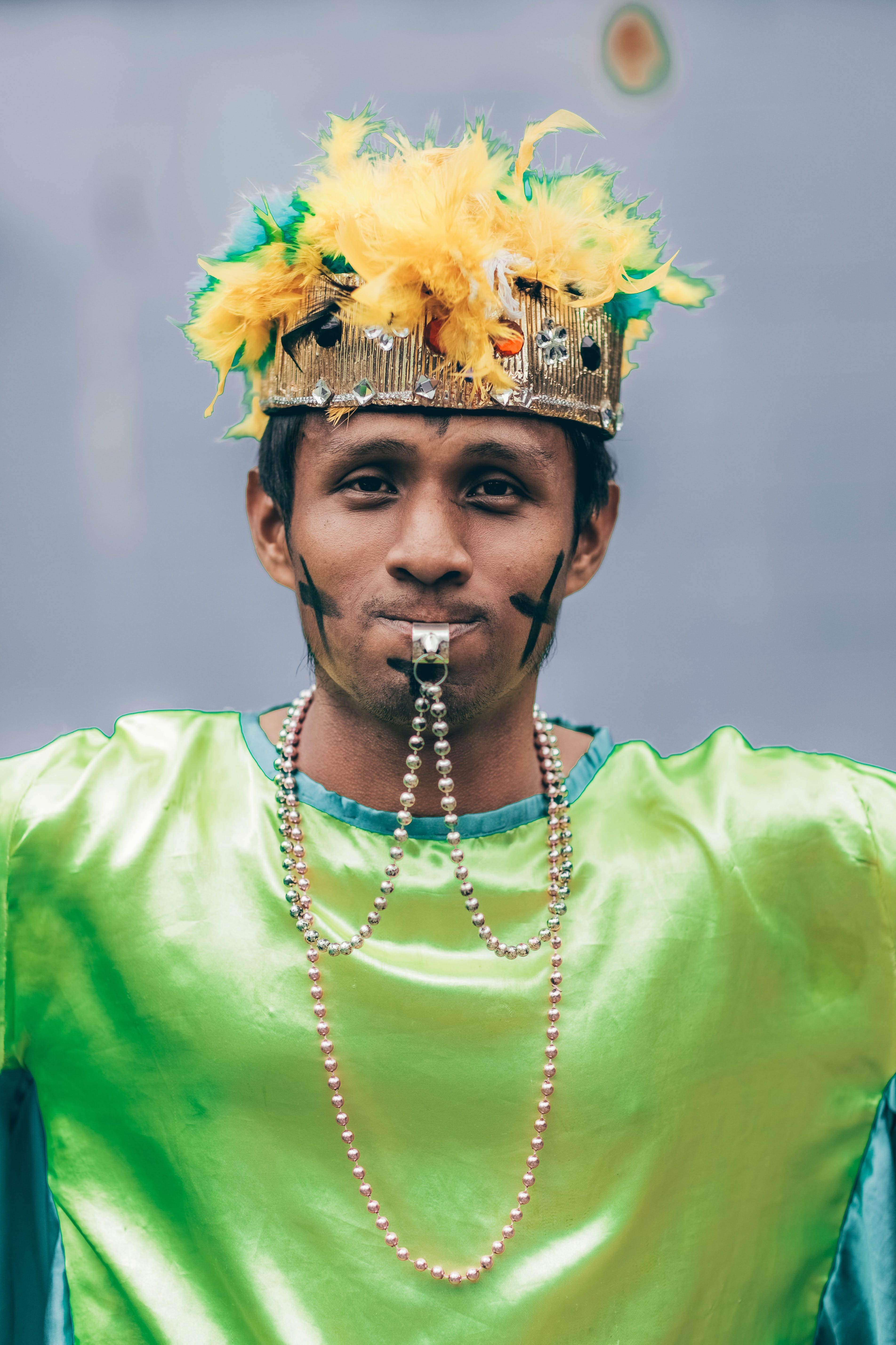 Man Wearing Headdress With Whistle In His Mouth