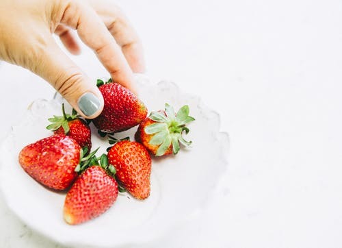 Person Holding Strawberry Fruit