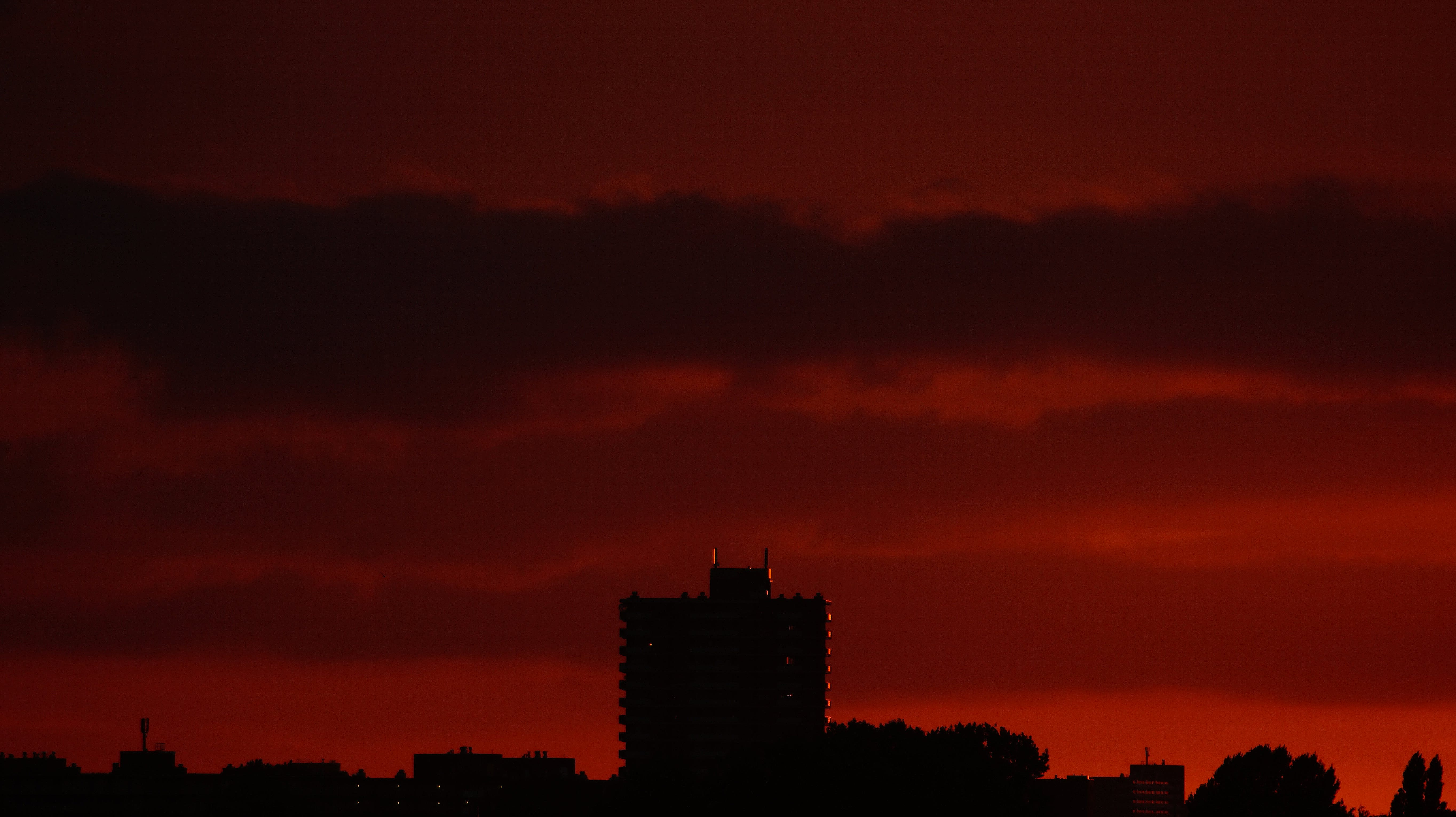 Silhouette of Building Structures Against Red Skies