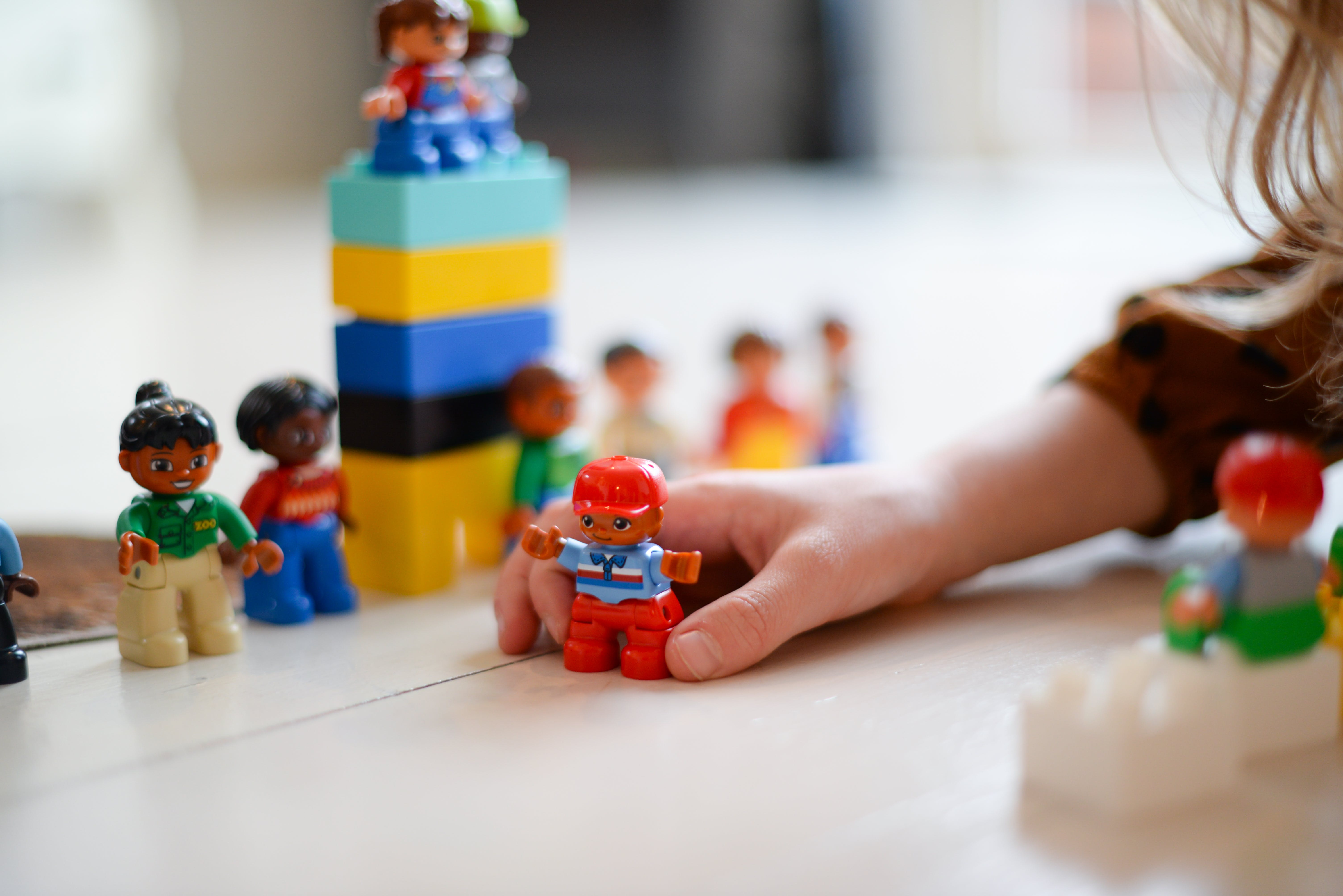 Person Playing Lego Mini Fig