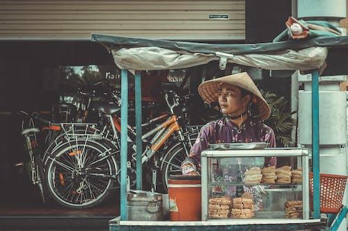 Darmowe zdjęcie z galerii z azjatka, handel, kapelusz, kobieta