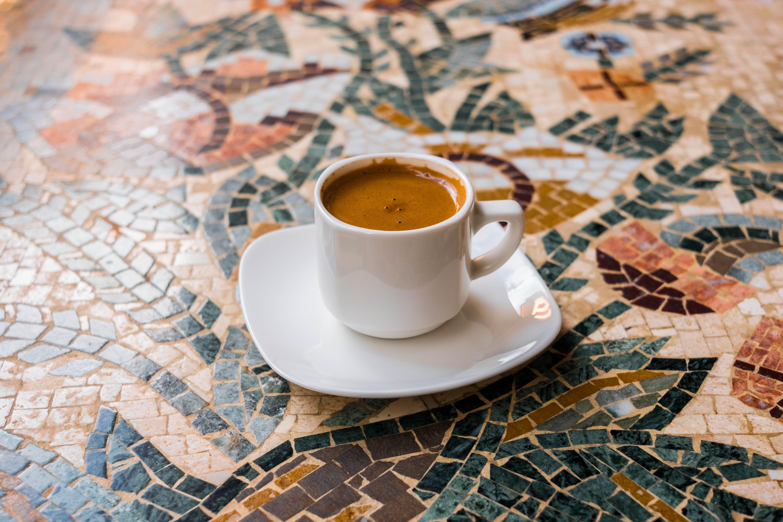 Mug Filled With Coffee On Saucer
