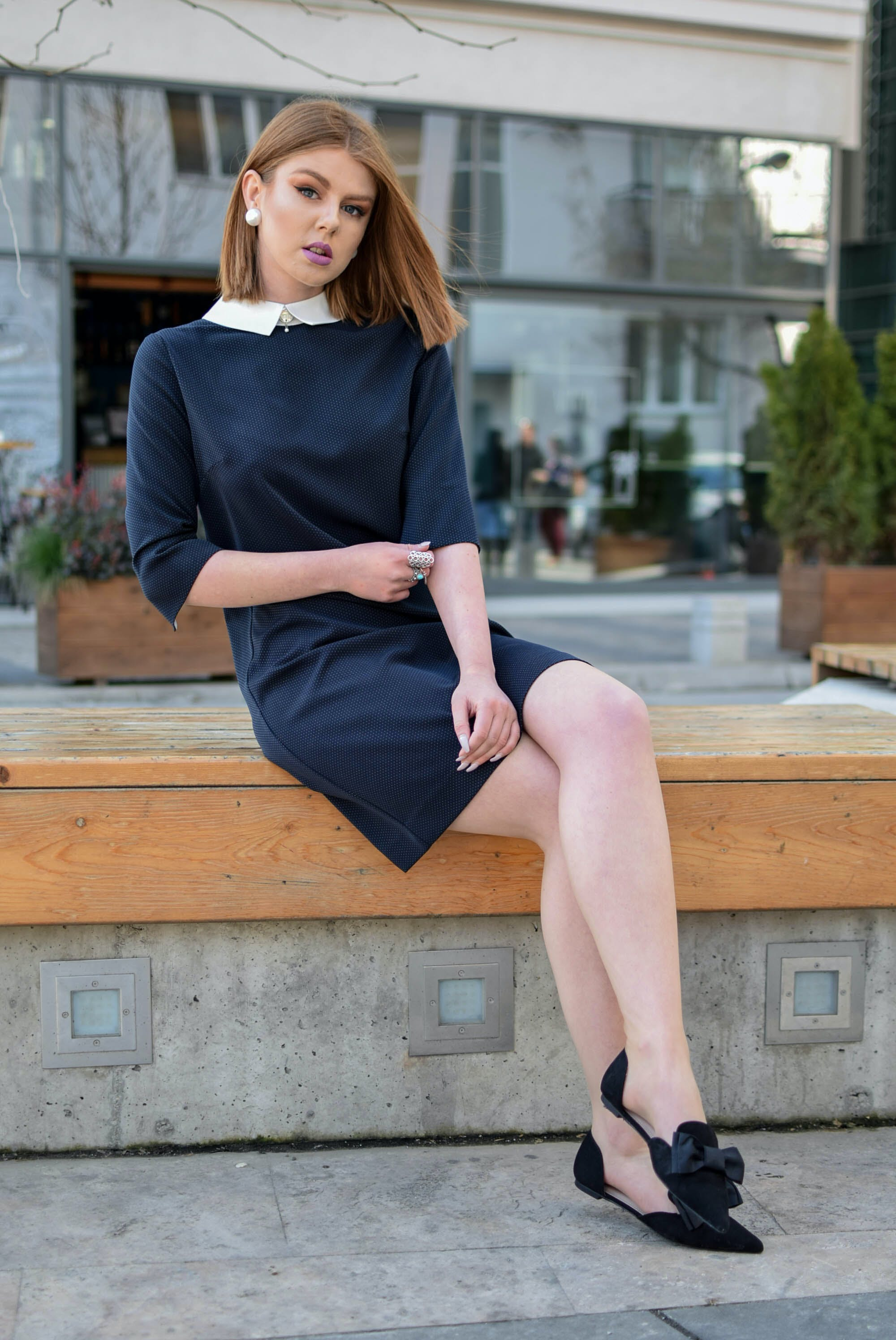 Photo of Woman Sitting on Bench
