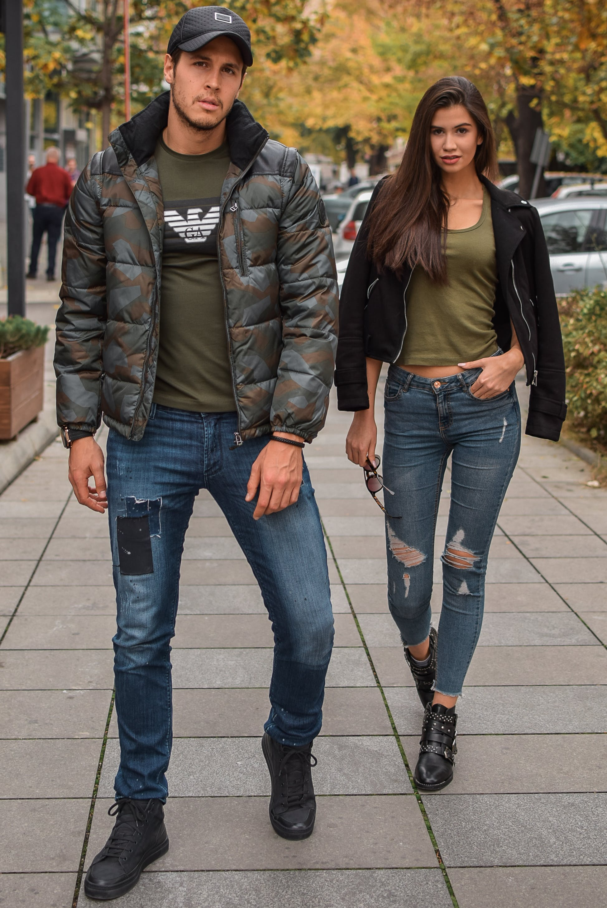 Photo Of Man And Woman Standing On Pavement