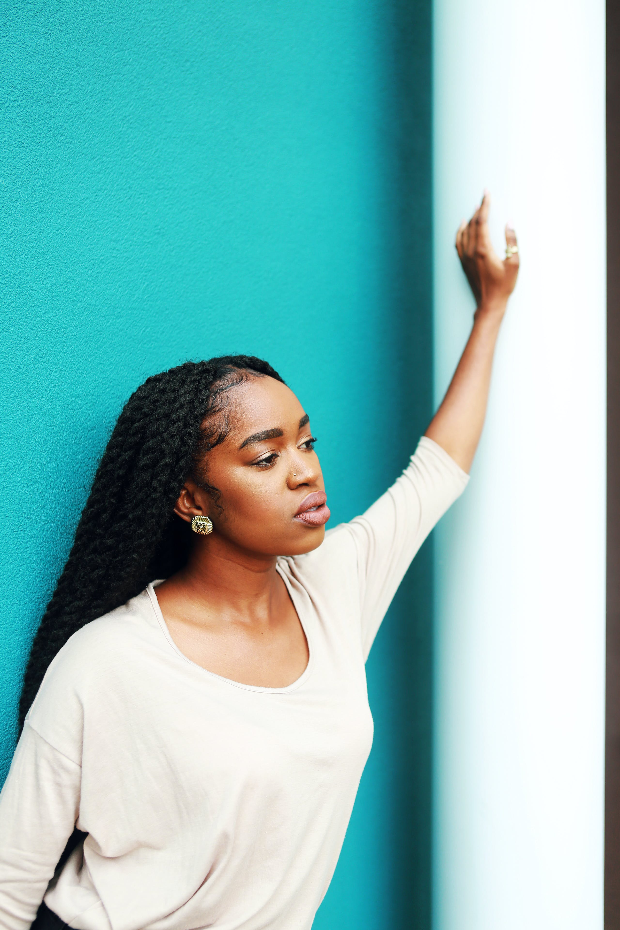 Woman Leaning Left Hand on Wall