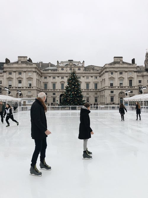 Man and Woman Ice Skating