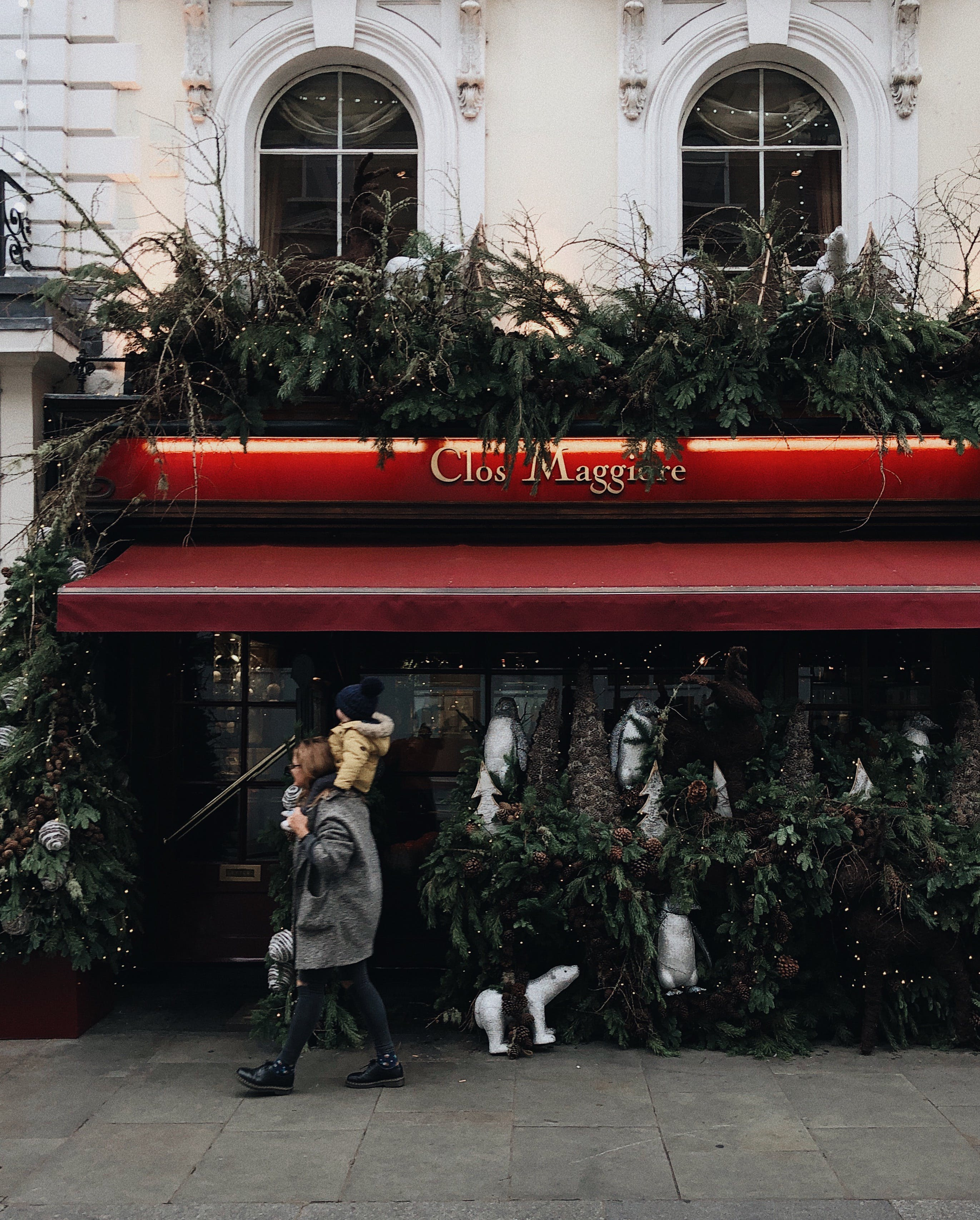 Woman Carrying Child Near Clos Maggiore Stall