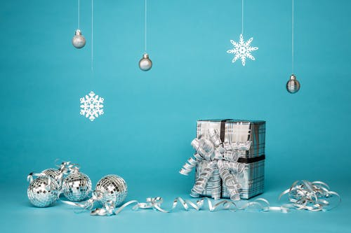 Gift Box Surrounded By Grey Baubles
