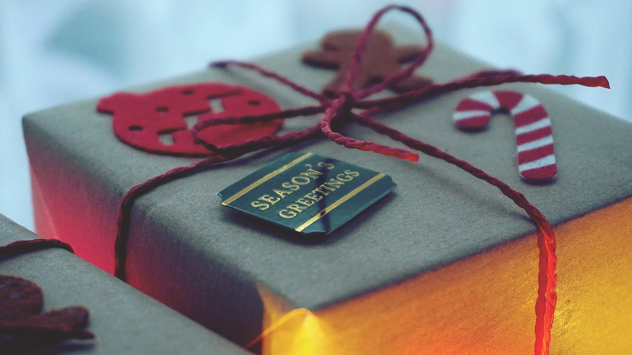 Close-Up Photo of a Gift Box Wrapped With Red String
