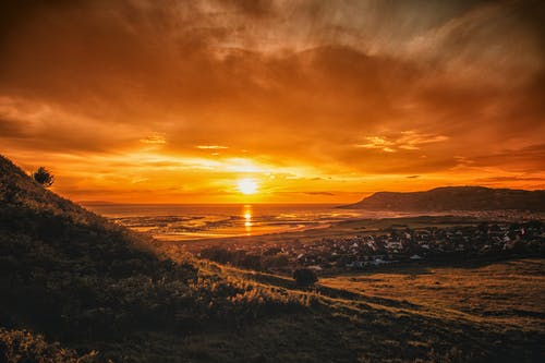 Immagine gratuita di alba, costa, mare, ora d'oro