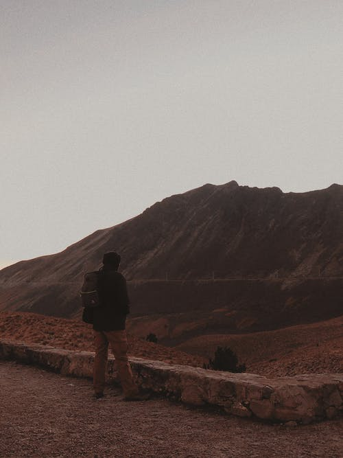 Man in Black Jacket Standing on Mountain