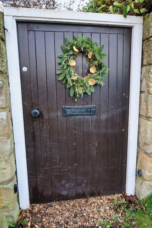 Free stock photo of brown, christmas, christmas door, Christmas wreath