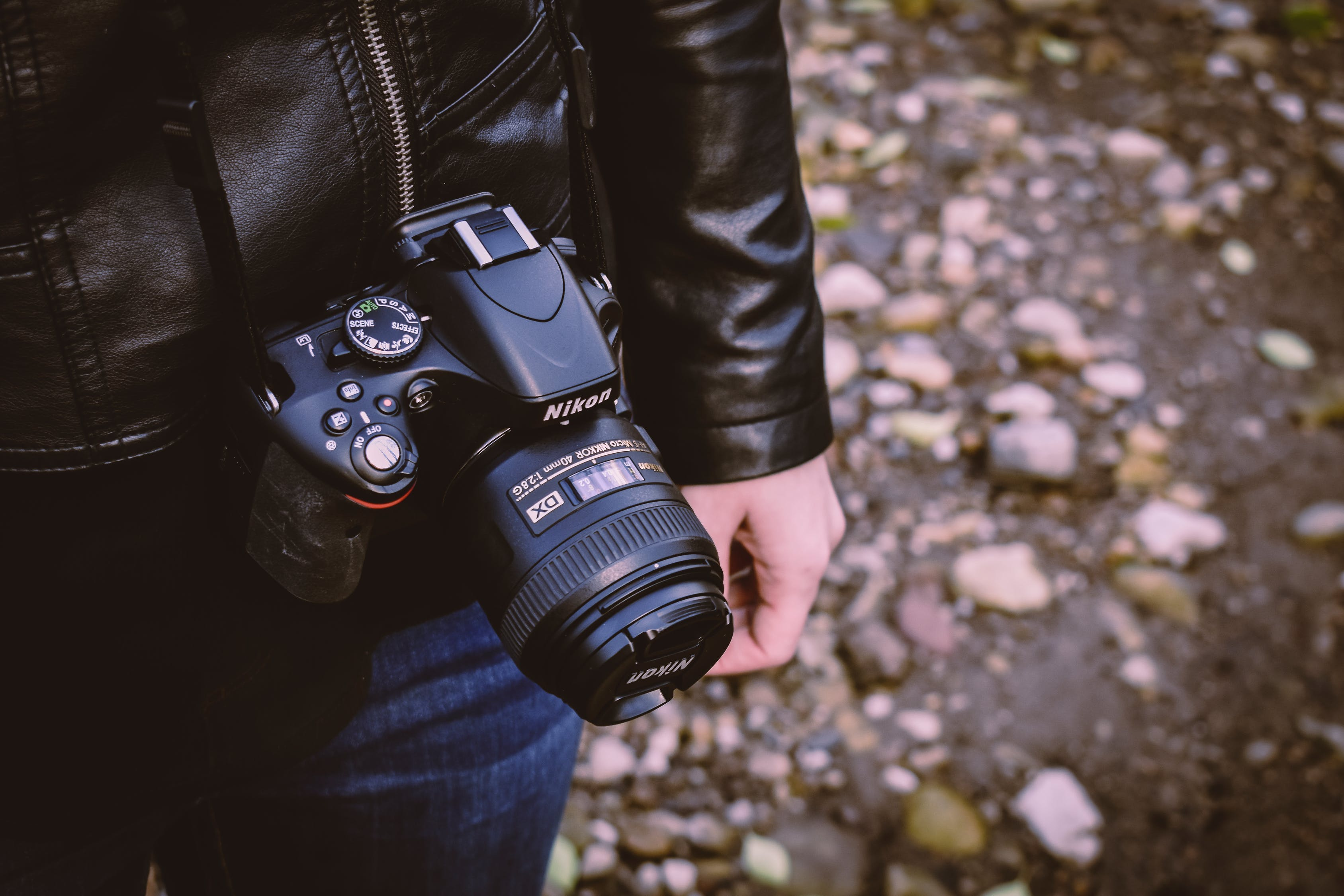 A person is carrying a nikon d5600 camera
